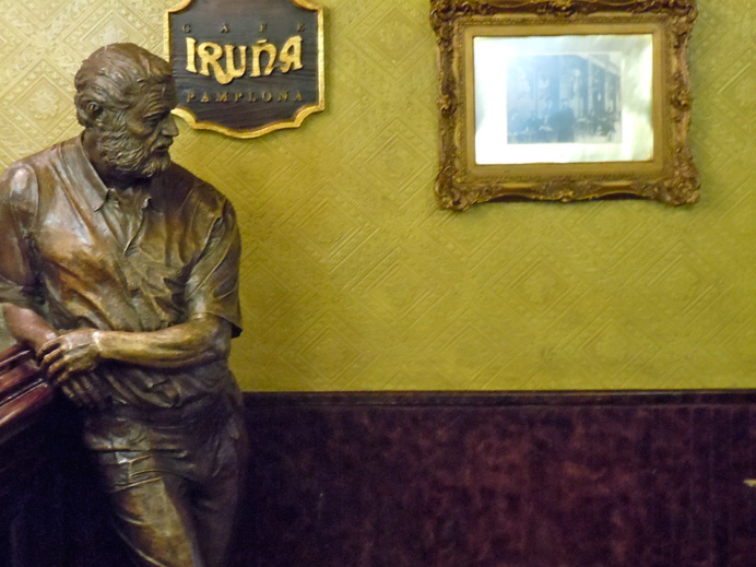 Life-size bronze of Hemingway in one of the author\'s favorite spots, Cafe; Iruna, Pamplona